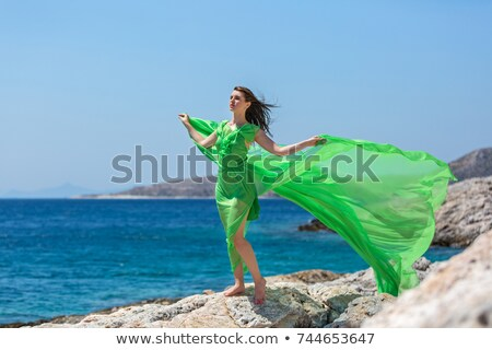 woman in green dress barefoot Stock photo © imarin