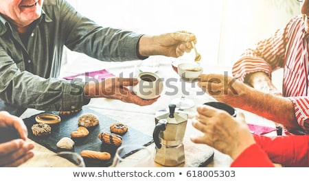 Elderly woman eating biscuits and drinking tea Stock photo © photography33