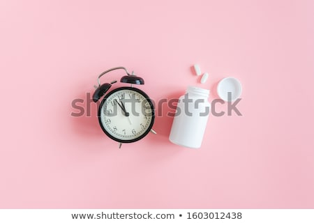 clock and pill bottle stock photo © devon
