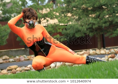 Stok fotoğraf: Woman In Latex Corset And Gas Mask