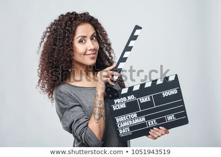 Brunette woman with movie slate Stock photo © photography33