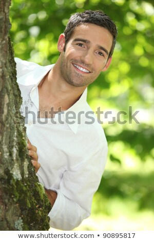 Kiekeboe man witte shirt boom natuur Stockfoto © photography33