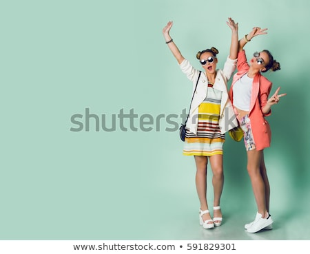 two beautiful women in a colored dress  stock photo © Lupen
