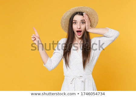 Stock photo: portrait of young woman wearing head dress