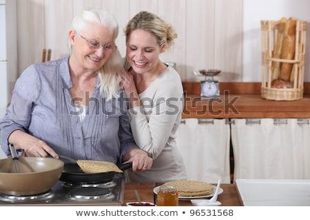 Hölgy lánygyermek főzés boldog eszik fiatalság Stock fotó © photography33