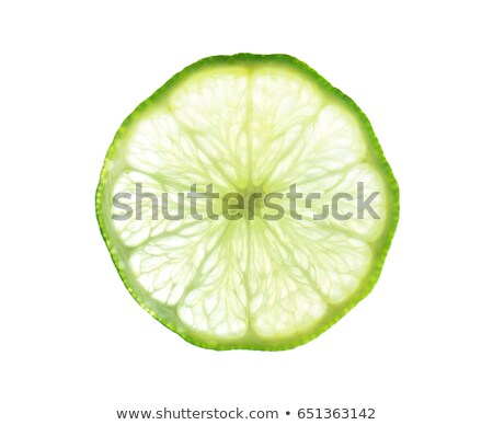Slice of lime, backlit and isolated on white. Stock photo © ozaiachin