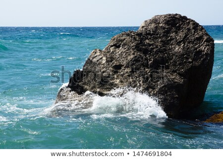 giant boulders washed by ocean waves stock photo © chrascina