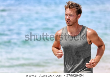 Handsome man during workout Stock photo © dash