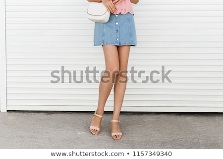 female legs in pink sandals on pink background Stock photo © Nobilior