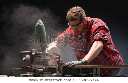 Stok fotoğraf: Man Using Powerful Electric Saw