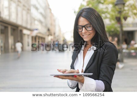 üzletasszony · érintőképernyő · tabletta · ül · irodai · asztal · dolgozik - stock fotó © adamr