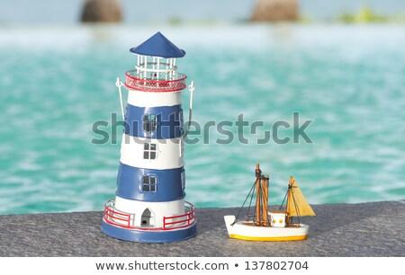 Klein speelgoed zeilschip strand zee man Stockfoto © tannjuska