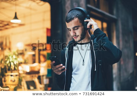 young casual man on the phone Stock photo © feedough