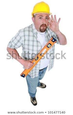 Builder with spirit-level holding hand to ear Stock photo © photography33