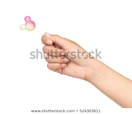 Hand holding spiral lollipop Stock photo © Taigi