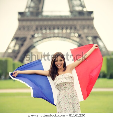 Funny Eiffel tower holding a French flag stock photo © pcanzo