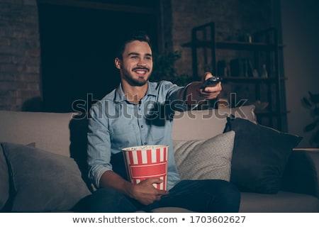 молодые бакалавр человека домой мебель интерьер Сток-фото © photography33