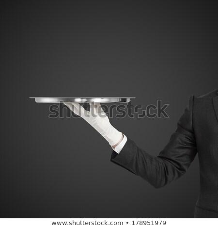smiling waitress holding empty silver tray stock photo © wavebreak_media