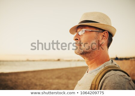 Carefree man by the seaside Stock photo © photography33