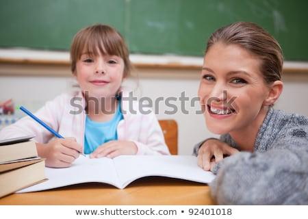 mosolyog · tanár · kettő · diákok · könyv · boldog - stock fotó © luminastock