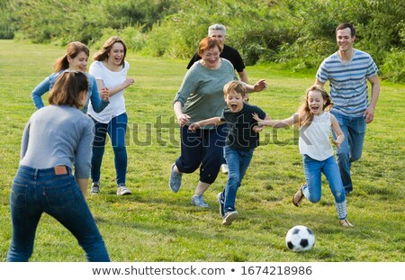 Kids playing sport with grandfather stock photo © sdenness