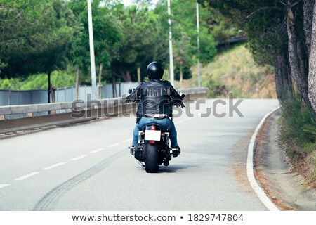 A macho motorcycle rider wearing his leather jacket Stock photo © pxhidalgo