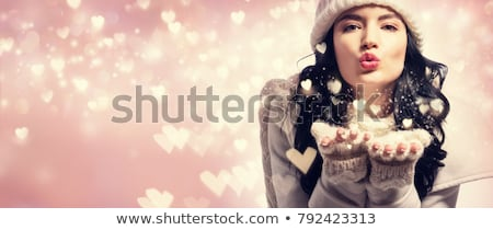woman blowing on snow Stock photo © diego_cervo