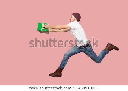 side a young man in jeans shirt and christmas hat stock photo © feedough
