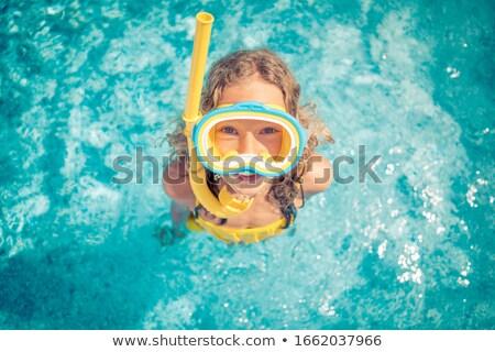 happy children diving in the pool Stock photo © meinzahn