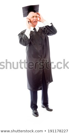angry senior male graduate talking on a mobile phone stock photo © bmonteny