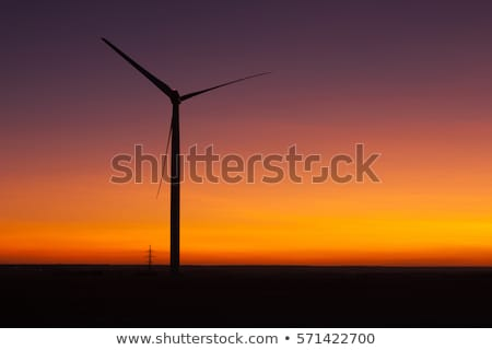 Windfarm at sunset and sky with dust from volcano Stock photo © CaptureLight