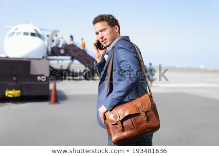 young casual business man wearing a leather jacket  Stock photo © feedough