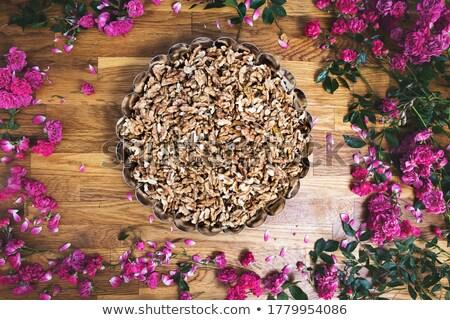 Walnut Kernels in Bowl on Brown Rustic Wood Plank Background Stock photo © stevanovicigor