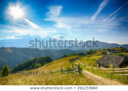avond · zonsondergang · berg · heuvels · dorp · zemelen - stockfoto © constantinhurghea