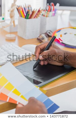 Designer using graphics tablet and colour charts Stock photo © wavebreak_media