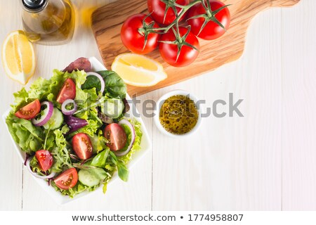 Healthy salad with tomatoes, cucumber, spinach and cabbage Stock photo © jaffarali