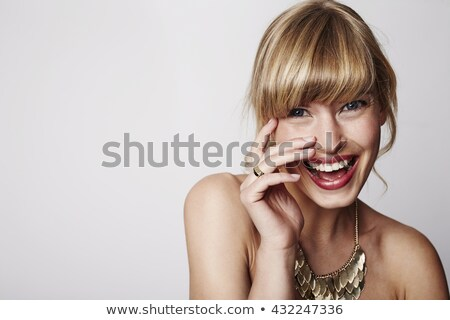 Blond woman with necklace and smile. Stock photo © lubavnel