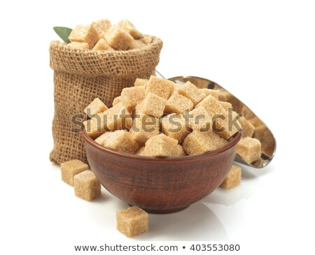 Cane brown sugar cubes in a burlap sack Stock photo © ironstealth