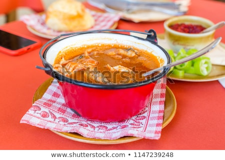 Hungarian fish soup Stock photo © digoarpi