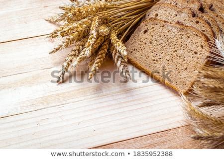 Crusty fresh bread loaf border on wood Stock photo © ozgur