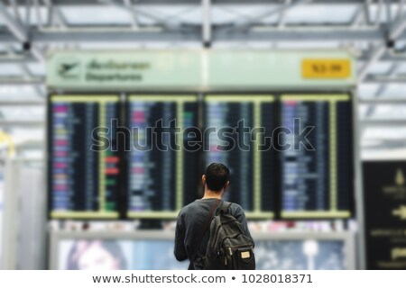 man looking at departure board stock photo © rastudio