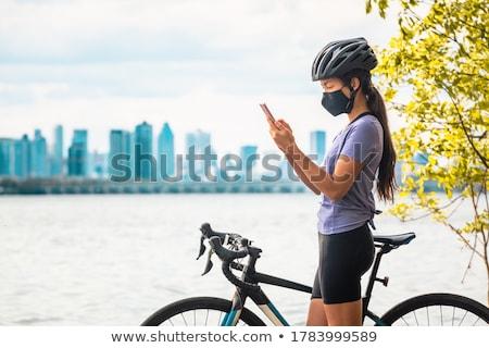 nő · bicikli · park · ősz · felismerhetetlen · vonzó - stock fotó © stevanovicigor