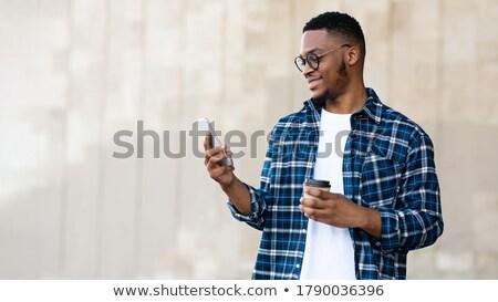 портрет удовлетворенный афро американский человека питьевой Сток-фото © deandrobot