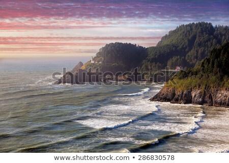 Cabeza faro brumoso puesta de sol playa azul Foto stock © davidgn