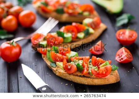Bruschettas with tomatoe and avocado.  Stock photo © user_10493298