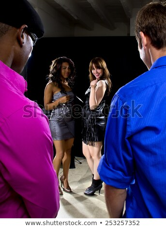 Stock photo: Nightlife - Handsome Man Seducing A Beautiful Lady