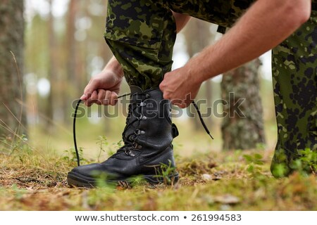 Man tying bootlaces in the forest Stock photo © wavebreak_media
