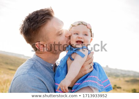 father embracing his daughter in park stock photo © wavebreak_media