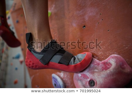 Low section of woman practicing rock climbing Stock photo © wavebreak_media