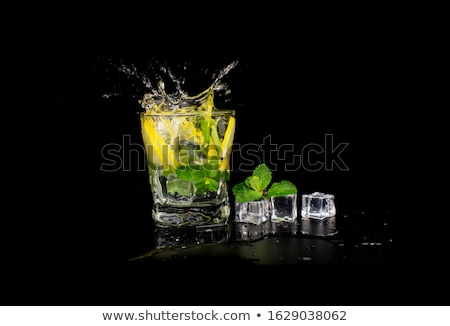 Stockfoto: Refreshing Mint Cocktail Mojito With Rum And Lime Cold Drink Or Beverage With Ice On Black Backgrou